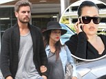 Kourtney Kardashian dresses her bump in a stylish ensemble as she enjoys casual outing with Scott Disick in the Hamptons... as Khloé jets out of LAX to join them