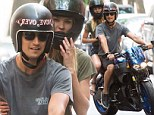 Bonding on a bike: Candice Swanepoel and her beau Hermann Nicoli took a motorcycle ride around New York City on Sunday