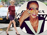 Heidi Klum struts to Project Runway set in maroon and plum ensemble before getting patriotic with black, red and yellow finger paint as Germany claims World Cup victory