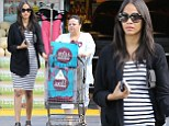 Shop 'til you pop! Zoe Saldana shows off her burgeoning belly as she buys groceries with mother Asalia in Los Angeles