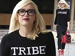 The fashionable Tribe! Gwen Stefani keeps it rocker chic in black overalls and lace-up heels while on a casual outing