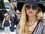 She's a hippie chick! Rachel Zoe goes retro in '70s floppy hat and denim bell bottoms while out with son Skylar