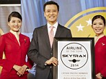 Winner: Ivan Chu of Cathay Pacific Airways is seen holding the Airline of the Year 2014 award