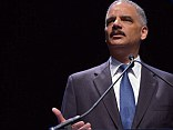 Attorney General Eric Holder said today that America has made significant progress since the Civil Rights Act was signed in 1964, but 'too many' Americans still face discrimination in society