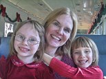 Happy family: Theresa Gorski, a long-time attorney working for a legal aid society, pictured with her daughters two years before her tragic murder