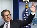 Who's going to get him? Jay Carney, seen here waving goodbye following his final White House press conference June 18, is rumored to be in the running for a job at both Apple and car service app Uber