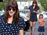 Retro chic! Selma Blair displays slender legs in polka dot romper as she hits Beverly Hills with her smiling son Arthur