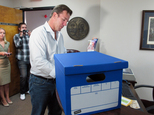 Former South Carolina Treasurer Thomas Ravenel fills out paperwork Monday, July 14, 2014, at the state Election Commission headquarters in Columbia, S.C.,  t...