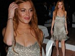 She's a shining star again! Lindsay Lohan displays her slender figure in sparkling fringe gown while at Italian film festival