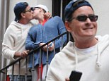 Charlie Sheen kisses former porn star fiancée Scottine Sheen as he whisks her off to Pamplona for the Running Of The Bulls
