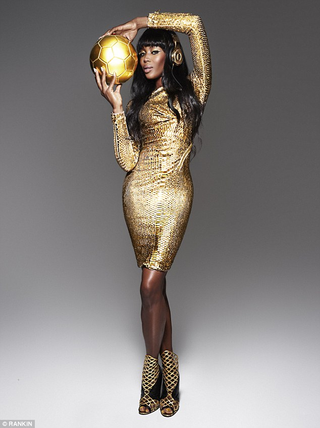 Golden touch: Naomi Campbell poses as the World Cup with a pair of the 24 carat gold Beats by Dre headphones each of the German team will get after beating Argentina in the 2014 final