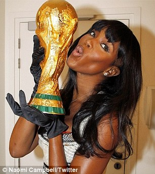 The real thing: Naomi tweeted an old picture of her with the Jules Rimet trophy before the final