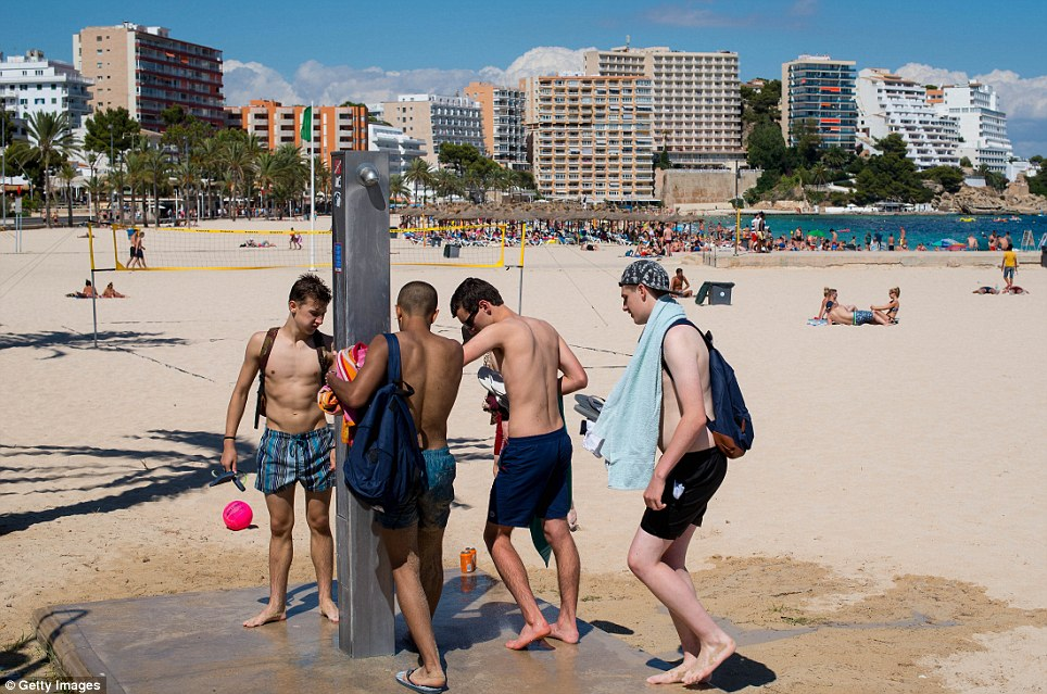 A group of young men on the beach in Magaluf which hit the headlines recently for its party-scene