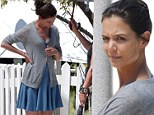 No, she's not pregnant again: Katie Holmes sports FAKE baby bump as she films scene with Ryan Reynolds and Helen Mirren for Woman In Gold