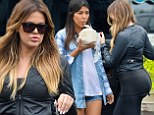 The gym is paying off! Khloe Kardashian shows off her pert posterior as she and sister Kourtney leave a market in New York