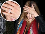 Something to tell us? Mena Suvari wears diamond sparkler on her ring finger after previously denying engagement to Salvador Sanchez