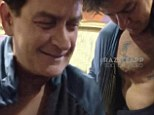 'I'm so f***ing hammered!': Charlie Sheen has a bizarre encounter with fans at a Taco Bell drive-thru
