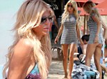 Summer sun! Victoria Silvstedt relaxes in between work while in Mykonos, Greece.