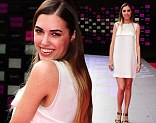 Amber Le Bon shows off her long, shapely legs in a floaty white tunic dress as she steps out for Kasabian premiere