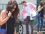 Mila Kunis satisfies her pregnancy cravings by grabbing burgers with Ashton Kutcher