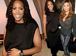 Pregnant Kelly Rowland lays a protective hand on her growing baby bump as she poses with Beyonce's mom Tina Knowles