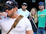 They're unlikely friends! Gerard Butler and Kellan Lutz bond in Rio over photos with ecstatic fans