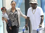 EXCLUSIVE: Tracy Morgan struggles to walk on a walker while visiting the doctor assisted by his family, fiancee model Megan Wollover and their first child, daughter Maven, in Midtown, New York City. <P> Pictured: Tracy Morgan, Megan Wollover, Maven Morgan <B>Ref: SPL802751  160714   EXCLUSIVE</B><BR/> Picture by: Splash News<BR/> </P><P> <B>Splash News and Pictures</B><BR/> Los Angeles: 310-821-2666<BR/> New York: 212-619-2666<BR/> London: 870-934-2666<BR/> photodesk@splashnews.com<BR/> </P>