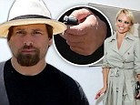 The ring is off! Pamela Anderson's estranged husband Rick Salomon leaves wedding band at home¿ one week after split announced