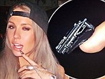 She's got her trigger finger ready: Imogen Anthony shows off her gun-themed manicure one day AFTER she posts 'violence CAN be the answer'