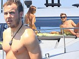 A winning formula! World Cup victor Mario Goetze shows off his shows off his toned frame during pre-season break with model girlfriend Ann-Kathrin Brommel in Ibiza