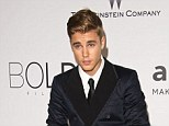Another delay: Justin Bieber's DUI case has been postponed until August 5 as attorneys work out plea deal, pictured in at Cannes Film Festival in May