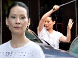 Plays a doctor on TV: Lucy Liu as Doctor Joan Watson filmed fight scenes on Tuesday in New York City for the CBS series Elementary