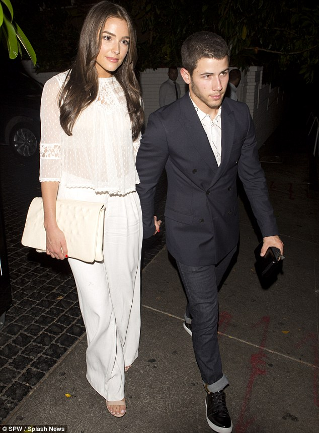 Night out: The former Jonas Brothers member walked hand-in-hand with the 22-year-old beauty as the two headed out