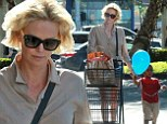 She's a trolley dolly! Charlize Theron looks like a pro as she pushes her own shopping cart on grocery run with son Jackson