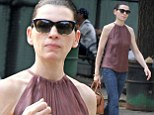 Julianna Margulies is casual but chic in sleeveless top and slim fitting jeans as she takes a stroll around New York City