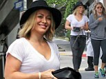 Style icon: Hilary Duff displays her shapely physique in skinny jeans and plain white T-shirt