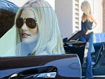 Rosie Huntington-Whiteley showcases her enviably long legs in Seventies-style flares as she enjoys an afternoon drive in LA
