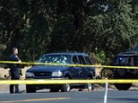 Violent: An American hostage has been killed and two others injured after three armed men robbed a bank and led police on a high-speed chase. Above, one of the hostages was thrown from this SUV (pictured) in the chase