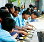 Rural school Students eating Mid Day Meal in Bangalore, Karnataka, India ( Primry School Children, Mid Day Meals )