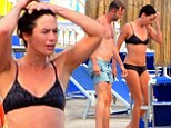 Bathing beauty: Lena Headey displays athletic physique during ocean swim in Italy ahead of being presented with Fantasy Award during Ischia Global Fest
