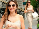Uptown girl! Miranda Kerr is the height of chic in fitted beige frock as she steps out in Manhattan
