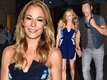 Caught in some drizzle: LeAnn Rimes and Eddie Cibrian dashed through the rain to a screening party of their new reality show LeAnn & Eddie in New York City on Tuesday