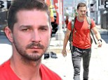 Seeing double: Shia LaBeouf stops to pump at the petrol station wearing the same exact outfit from last week