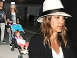 Home time: The actress arrives back in LAX from her family holiday