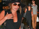 Moving on! Lea Michele holds hands with new beau Matthew Paetz at airport days after Twitter tribute to Cory Monteith