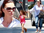 ¿Get back here!¿ Reality star Kyle Richards gently tugs her daughter¿s hair to prevent the five-year-old from running into traffic after a casual lunch in Los Angeles