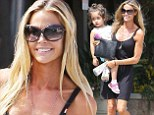 Mother and daughter: Denise Richards carried her daughter Eloise on Wednesday while out shopping in Malibu, California