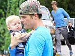 Father and son: Josh Duhamel carried his adorable son Axl on Wednesday as they arrived for weekly swimming lessons