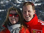 Road to recovery: Michael Schumacher, pictured here with his wife Corinna, fell while skiing in December