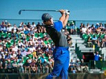 Clearing the way: Rory McIlroy leads after the first day at the Open Championship